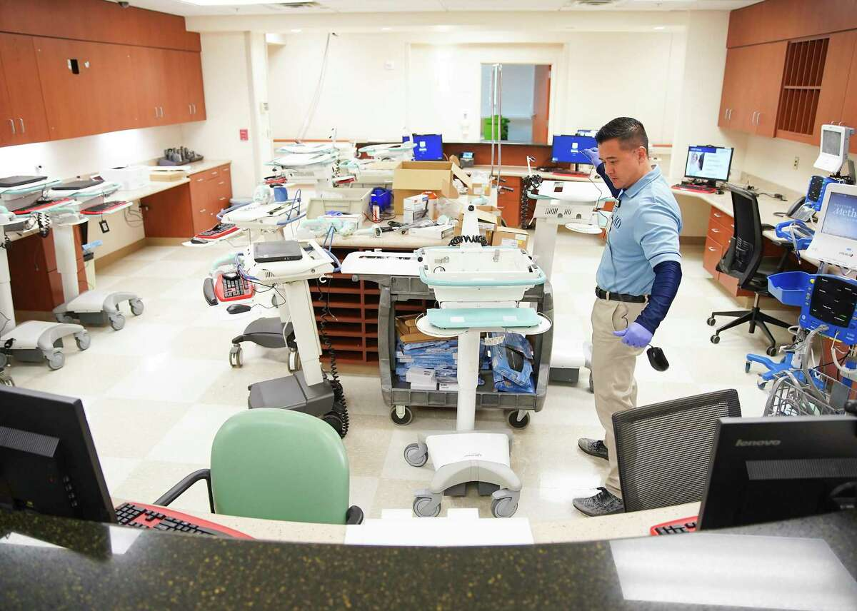 Danny Chang, a senior tech analyst for Houston Methodist, sets up computers on wheels for a special wing at the hospital's Katy campus that will be dedicated to those with coronavirus on Friday, March 13, 2020.