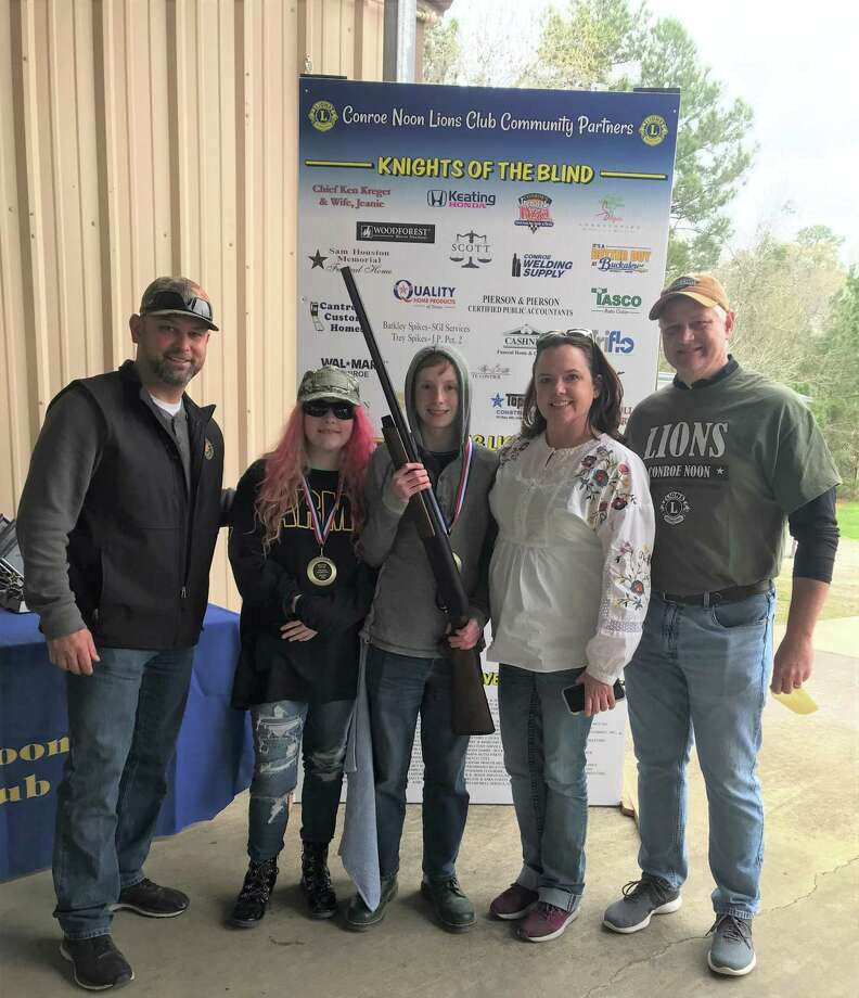 Winners - Not only did Jacob Ray (center) take 2nd Place in the Youth Division at the recent Conroe Noon Lions Club - Clay Shoot but his mom Rebecca Ray (second from right) won a 12-guage semi-automatic shotgun in the gun raffle. Also pictured: Clay Shoot Chair-Jason Miller(left), 3rd place Youth Division winner Danielle Dollins (second from left) and Conroe Noon Lions Club President Scott Perry (far right). Photo: Courtesy Photo
