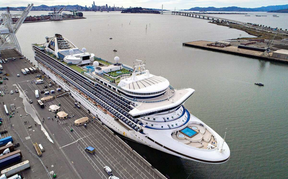 The Grand Princess cruise ship is berthed at the Ports America docks at the Port of Oakland in Oakland, Calif., on Monday, March 9, 2020. The Grand Princess cruise ship, which has been kept offshore as a precaution to prevent spreading the Covid-19 virus, docked to allow the passengers and crew to receive care and will be transferred to quarantine.
