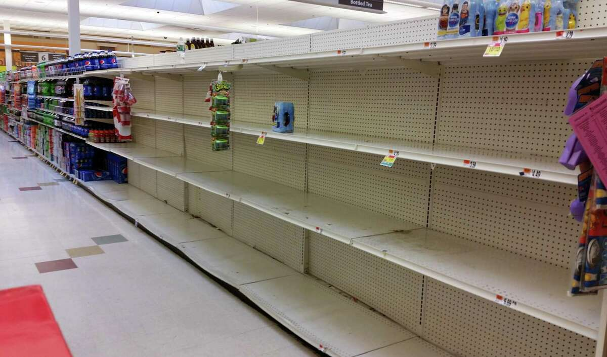 Shelves that once held gallons of water are now empty at the Stop & Shop in West Haven, Conn., on Friday Mar. 13, 2020.