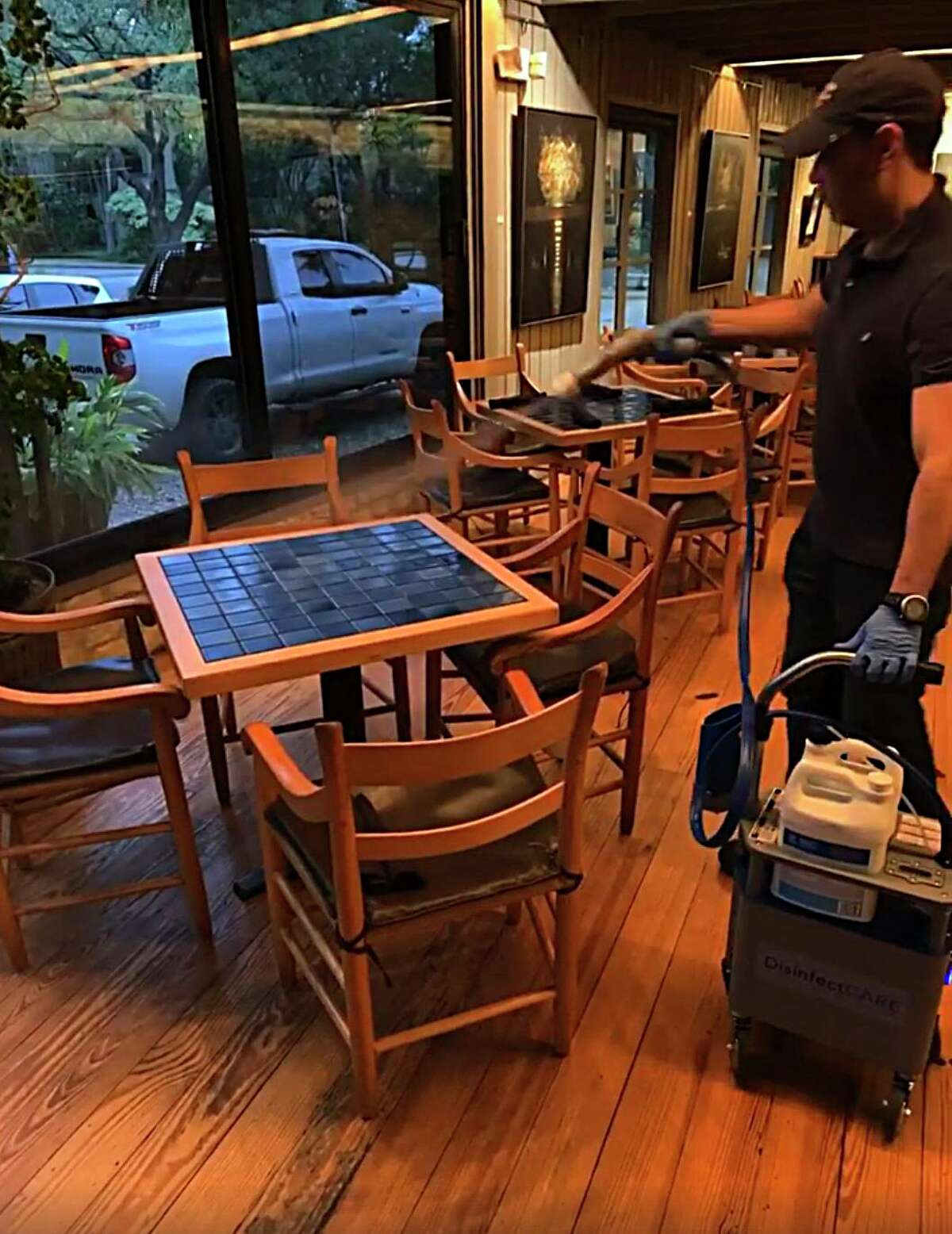 A worker with the San Antonio-based company DisinfectCare disinfects a dining room at Cappy's as the Alamo Heights restaurant takes steps to protect customers and staff during the novel coronavirus crisis.