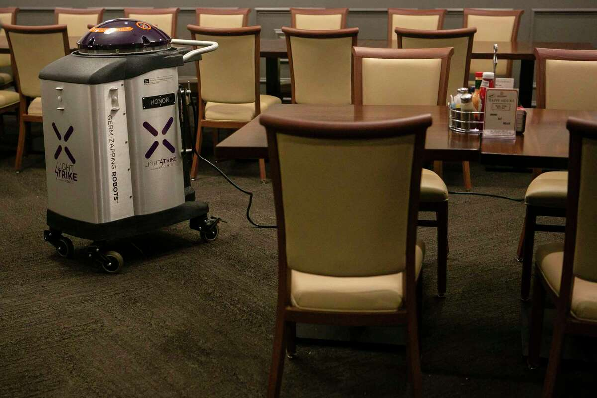 The Xenex LightStrike Germ-Zapping Robot, used by Max & Louie's New York Diner, on display during a demonstration at the restaurant in San Antonio, Texas, on March 13, 2020. Using pulsed xenon (a noble gas the robot emits an intense germicidal UV light. This light destroys microscopic bacteria and viruses that are potentially missed in a manual cleaning. The robot is a part of the diner's new protocols to keep customers and staff safe.