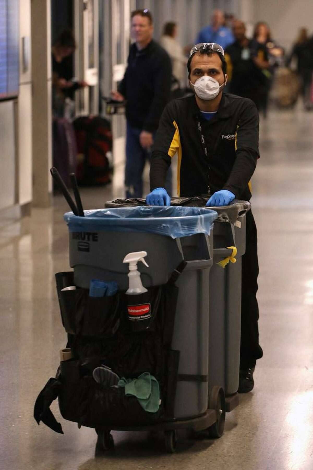 An airport employee cleans at Sky Harbor Airport on March 12, 2020 in Phoenix, Arizona. Yesterday President Donald Trump announced a ban on European travelers coming into the U.S. for the next 30 days in an attempt to combat the spread of the coronavirus (COVID-19).