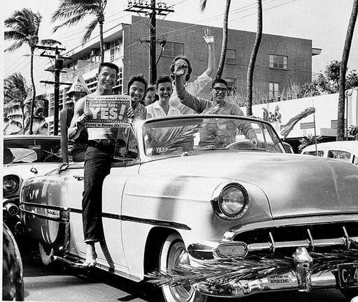 A group of supporters of statehood drive through the street in Waikiki, Honolulu, Hawaii, on March 13, 1959. Hawaii, a U.S. territory, will become the 50th state to join the Union on Aug. 21, 1959, with Honolulu as its capital. (AP Photo)