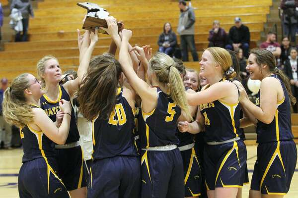 The Bad Axe girls basketball team celebrates its district championship after defeating Cass City on March 6 at Bad Axe High School. It was the first for the Lady Hatchets since 1980.
