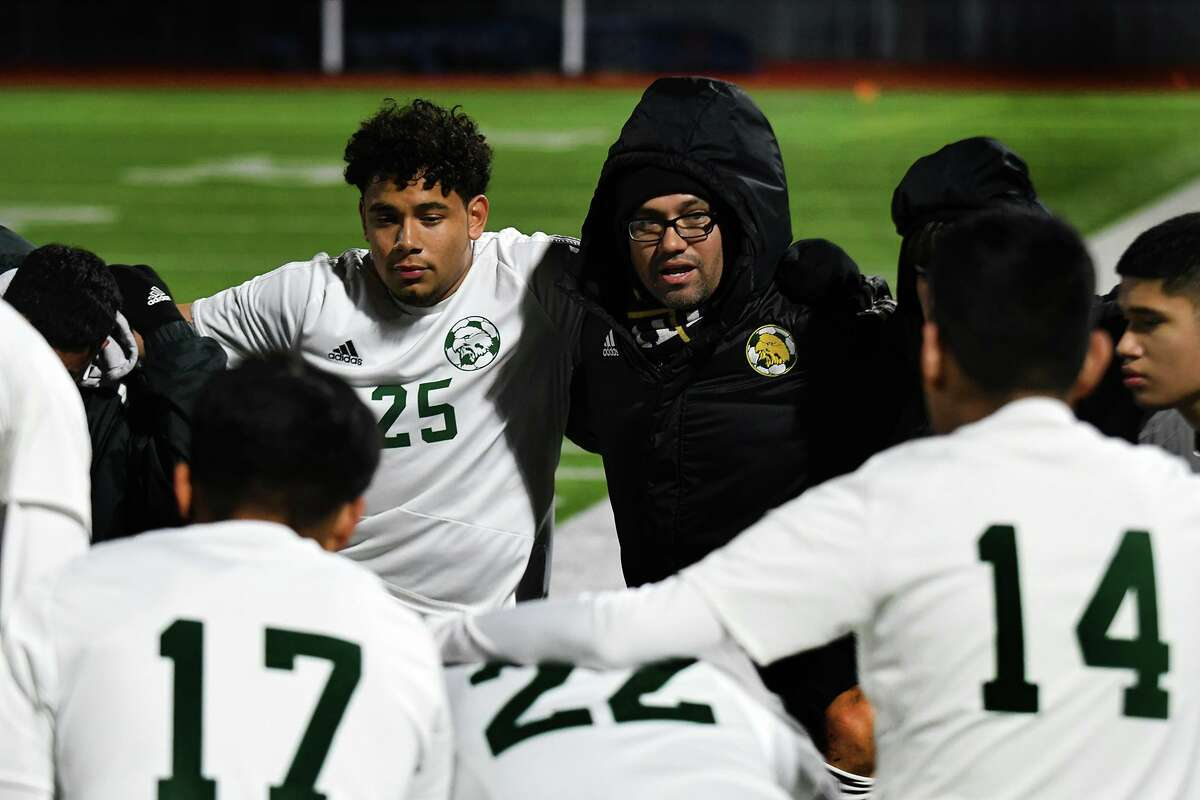 Klein Forest Head Boys Soccer Coach Chris Ramirez, with junior Cristian Reyes (25), pumps up his team before the start of their District 15-6A matchup with Klein Collins at KCHS on Feb. 20, 2020.