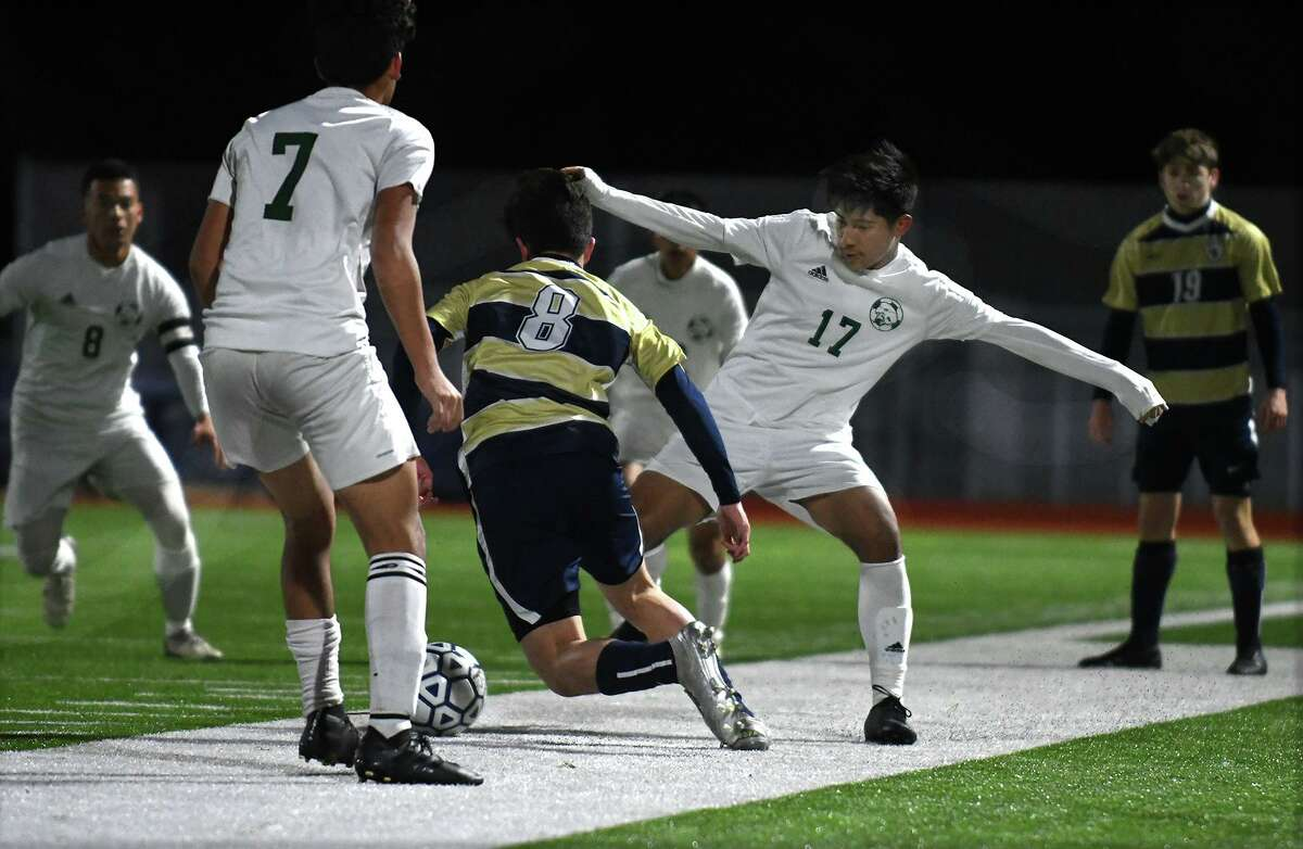 Klein Forest senior Giovani Rivera (17) works for control of the ball against Klein Collins junior midfielder Luis Angulo (8) during the 1st period of their District 15-6A matchup at KCHS on Feb. 20, 2020.