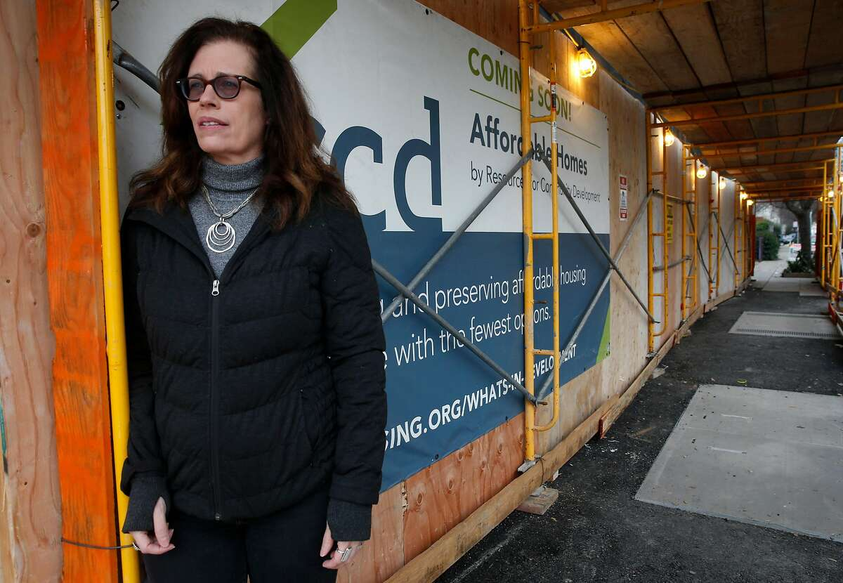 Elaine de Coligny, executive director of the nonprofit Everyone Home, visits the site of the Embark Apartments construction project in Oakland, Calif. on Friday, Dec. 14, 2018. Embark will have 62-units for veterans, half of which will be designated for homeless vets.