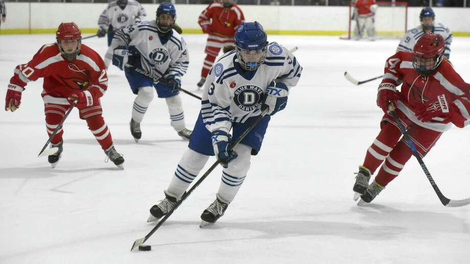 Darien's Catherine Martin (3) carries the puck down the ice against Greenwich during the FCIAC girls ice hockey semifinals at the Darien Ice House on Wednesday, Feb. 26, 2020. Photo: Dave Stewart / Hearst Connecticut Media / Hearst Connecticut Media