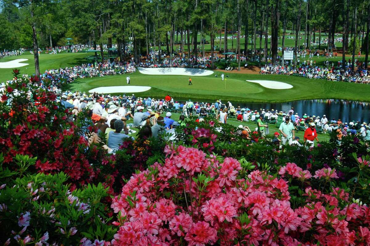 FILE - In this April 4, 2011, file photo, golf fans watch practice on the par three 16th hole during a practice round for the Masters at Augusta National Golf Club in Augusta, Ga. Augusta National decided Friday, March 13, 2020, to postpone the Masters because of the spread of the coronavirus. Club chairman Fred Ridley says he hopes postponing the event puts Augusta National in the best position to host the Masters and its other two events at some later date. Ridley did not say when it would be held. (Tim Dominick/The State via AP, File)