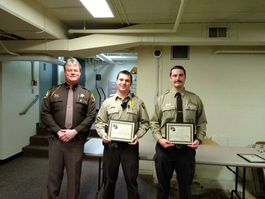 Sheriff Hanson, Jeff Ney and Charlie Stevens pose for a photo with their outstanding service awards. (Courtesy Photo)