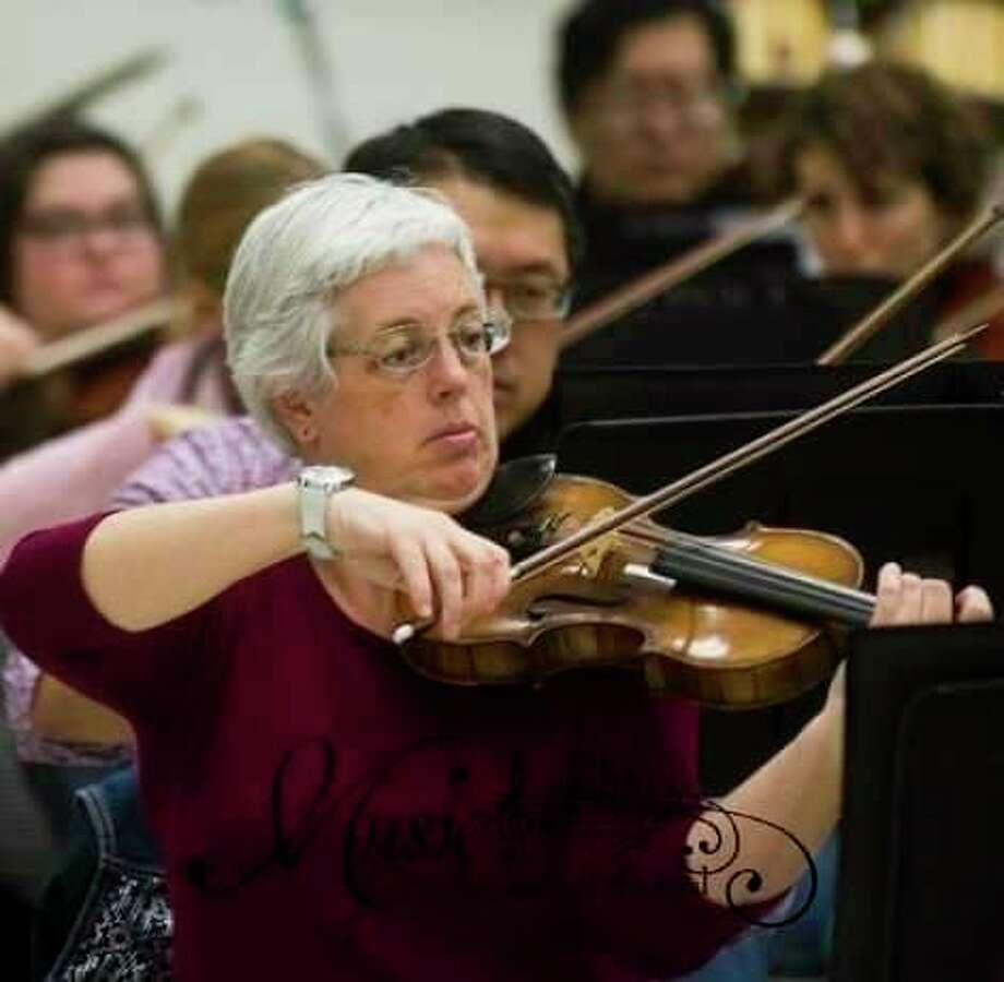 Susan Mercy performs in the orchestra for the event. (Photo provided)