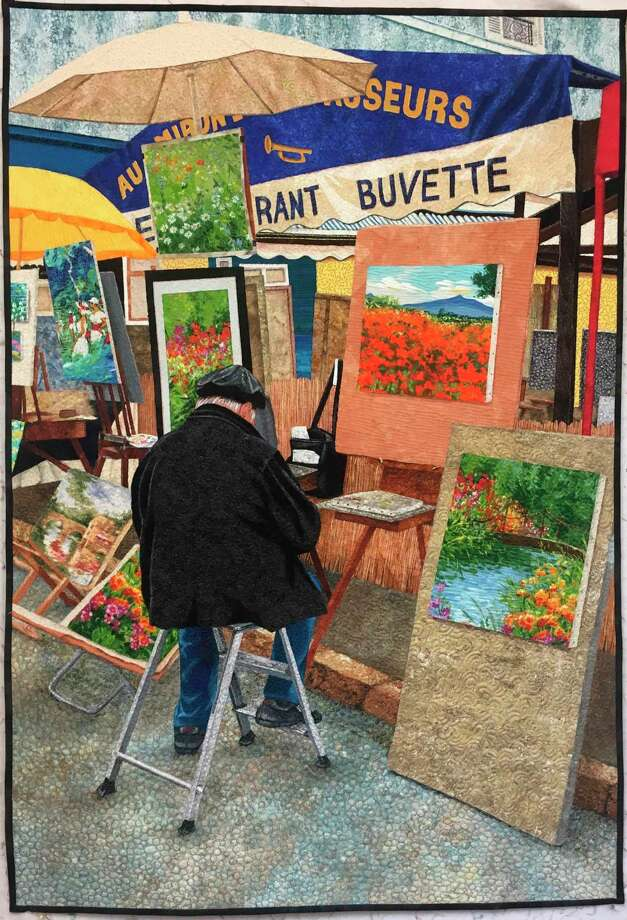 The Painter depicts an artist on the streets of Paris selling his work. Crawford designed the piece off of a picture she took in France on a recent trip and used a fusing technique. The final effect melds the material together to create an accurate reproduction of the picture, with just a couple of minor adjustments. (Photo  provided/American Quilter)