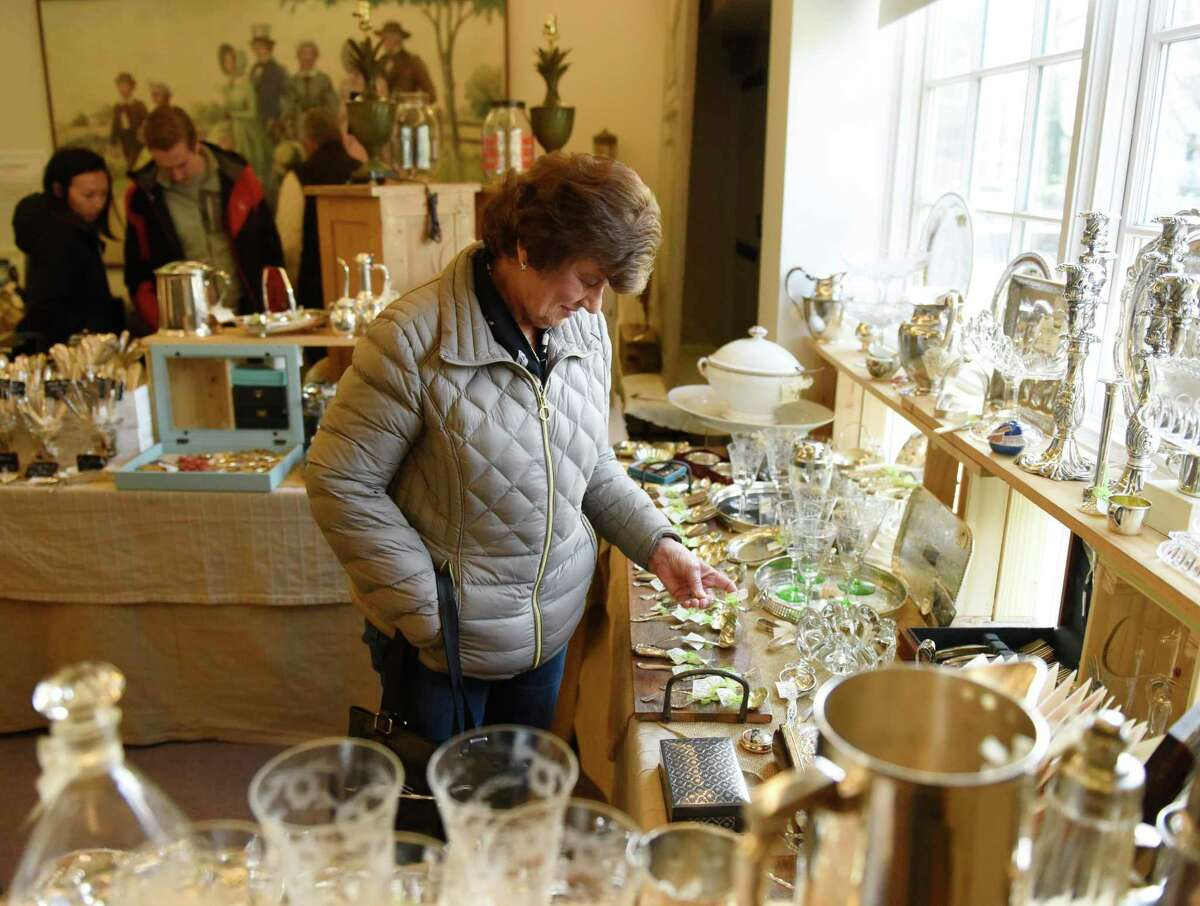 Barbara Chromczak, of Beacon Falls, N.Y., looks at items from the Jean Forte Vintage Gifts display at the New Canaan Art, Antique and Jewelry Show at the New Canaan Museum and Historical Society in New Canaan, Connecticut, recently. A variety of items including fine art, jewlery, watches, books, maps, and knick knacks were on display recently to benefit the Museum and Historical Society.