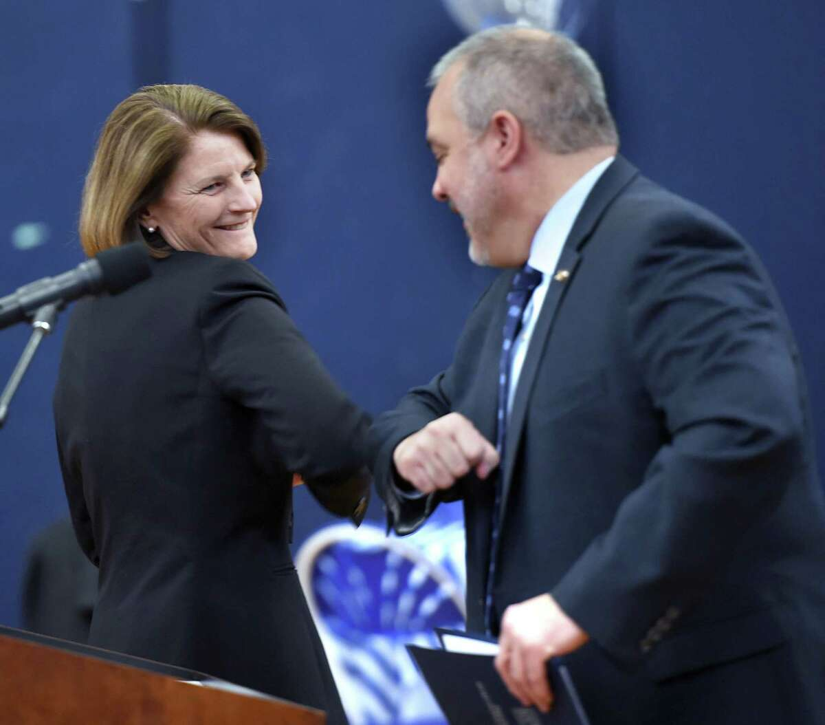 Sandra Bulmer, Dean of the College of Health and Human Services at Southern Connecticut State University, elbow bumps SCSU President Joe Bertolino after being introduced during event. Avoiding hand shaking is recommended to stop the spread of coronavirus.