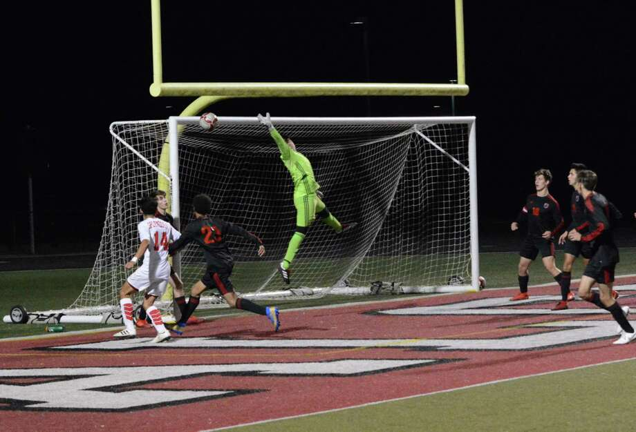 Hargrave goalkeeper Adrian Aguas (in green) makes a save during the Falcons' 4-0 win over Splendora at Falcon Stadium in Huffman on Feb. 28. Photo: Mark Sather