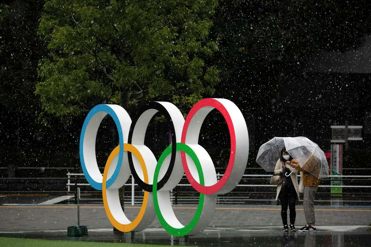 PHOTOS: Coronavirus outbreak in Houston  Snow falls on the Olympic Rings near the New National Stadium in Tokyo, Saturday, March 14, 2020. (AP Photo/Jae C. Hong) >>>See the Houston Chronicle's coverage of the coronavirus in photos ...