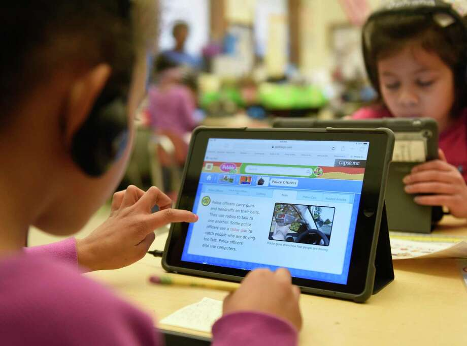 A student does research online before recording a video on the Seesaw app during class at Julian Curtiss School in Greenwich, Conn. Monday, Jan. 7, 2019. The Seesaw app lets students take photos, draw, and record videos of what they're learning in school and allows parents to see their work, monitor progress and send encouragement digitally. Photo: Tyler Sizemore / Hearst Connecticut Media / Greenwich Time