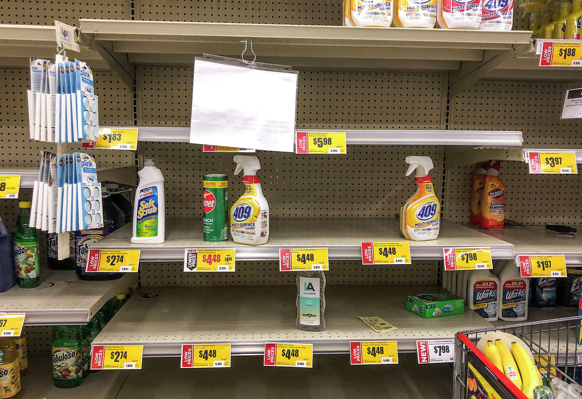 Disinfectants and other cleaning essentials sell out temporarily, despite rationing, at H-E-B amid growing COVID-19 cornonavirus concerns, Thursday, Mar. 12, 2020.
