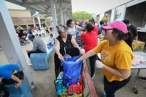 """""""Thank you, God Bless you"""" Maria Gomez, 65, said to volunteers as she gathered food during the Houston Independent School District along with the Houston Food Bank event where they handed out food to hundreds of families in need Saturday, March 14, 2020, in Houston. Gomez traveled an hour and half each way riding 2 buses to get food that she needed."""