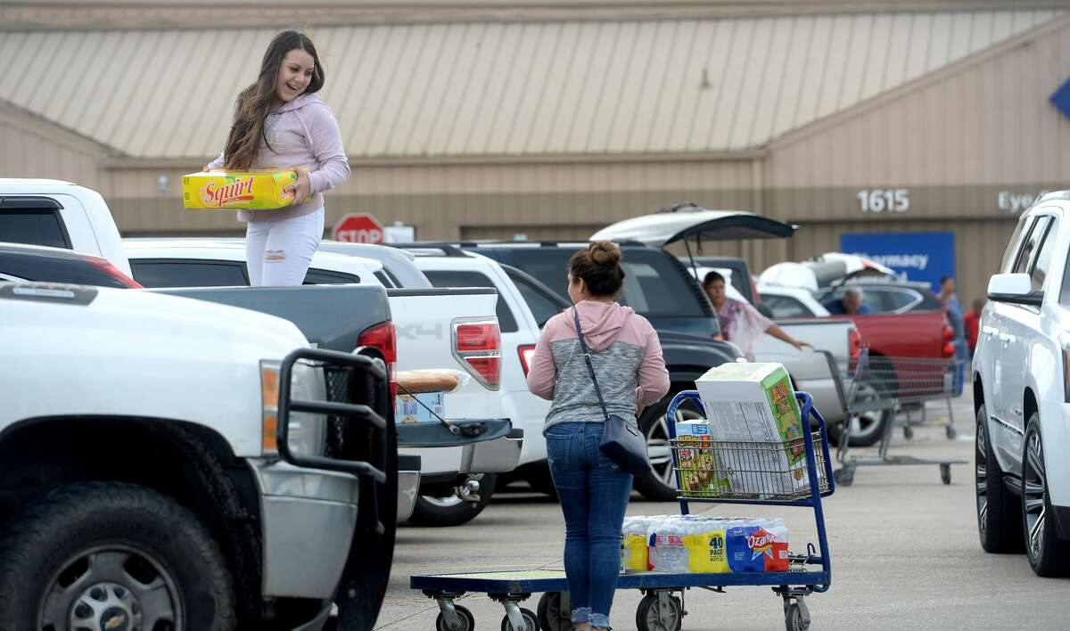 The lot is full at Sam's Club in Beaumont as shoppers hit local retailers to stock up in preparation for the potential spread of the coronavirus and quarantine conditions. Photo taken Friday, March 13, 2020 Kim Brent/The Enterprise
