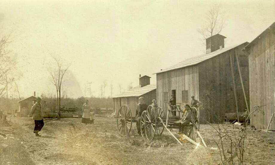 """Logging camp picture labeled """"Betsey River Orchard Camp"""", which also held anumber of women and children, located around corner of Longstreet roadand County Line Road. (Courtesy Photo)"""