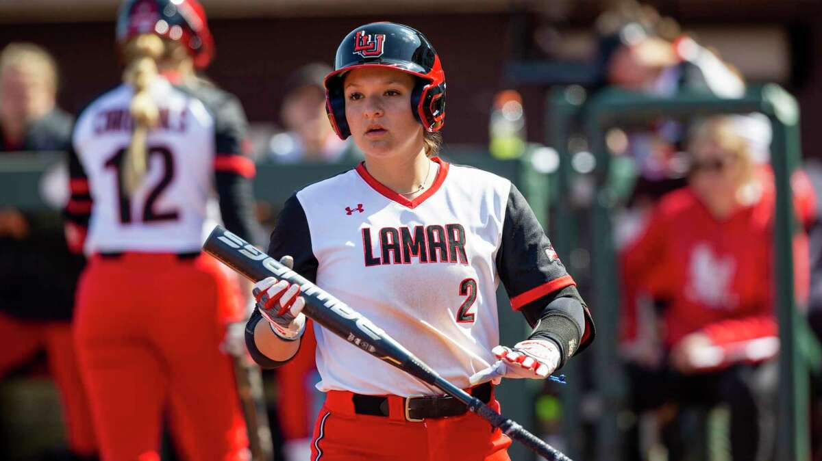 Lamar's Nicolette Ramirez (2) looks for signs against Texas A&M during an NCAA softball game, Saturday, Feb. 15, 2020, in College Station, Texas. (AP Photo/Sam Craft)