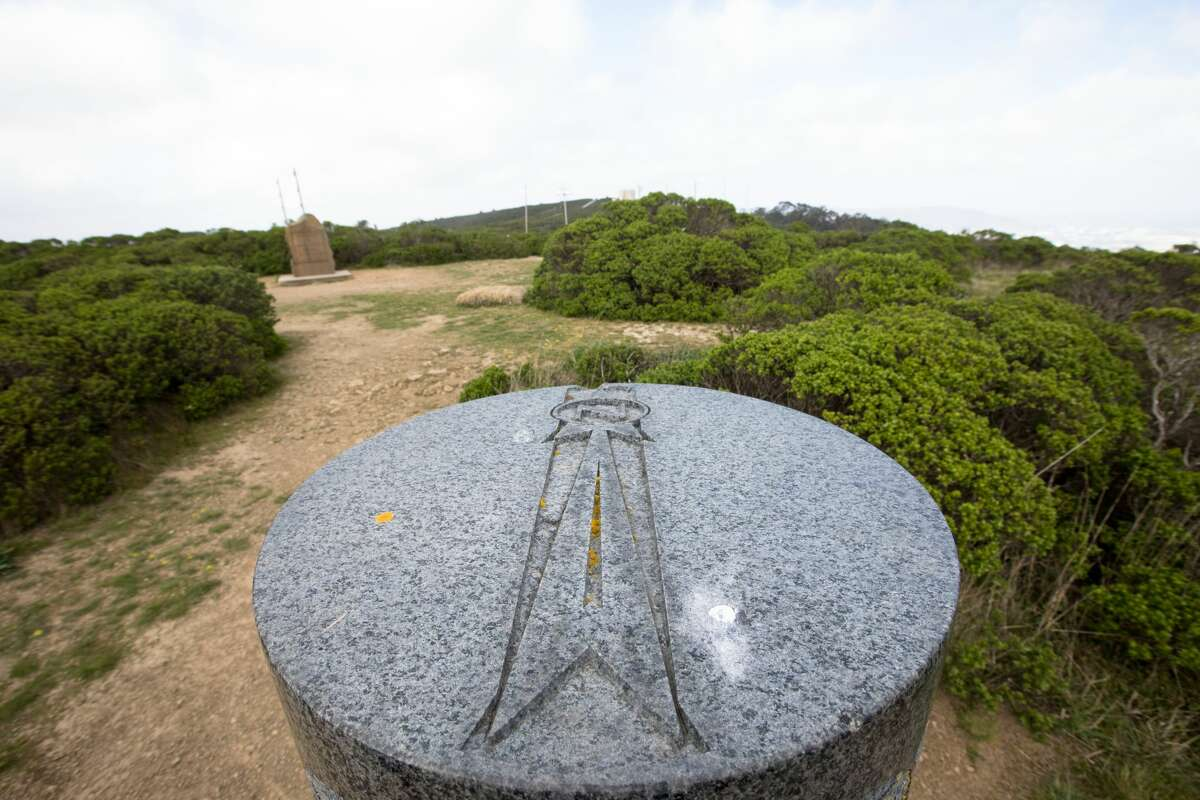 A marker at the San Francisco Bay Discovery Site points North. The Sweeney Ridge hike includes some steep climbs and remarkable views on the way to the San Francisco Bay Discovery Site. The site is where the Portola expedition discovered San Francisco Bay.