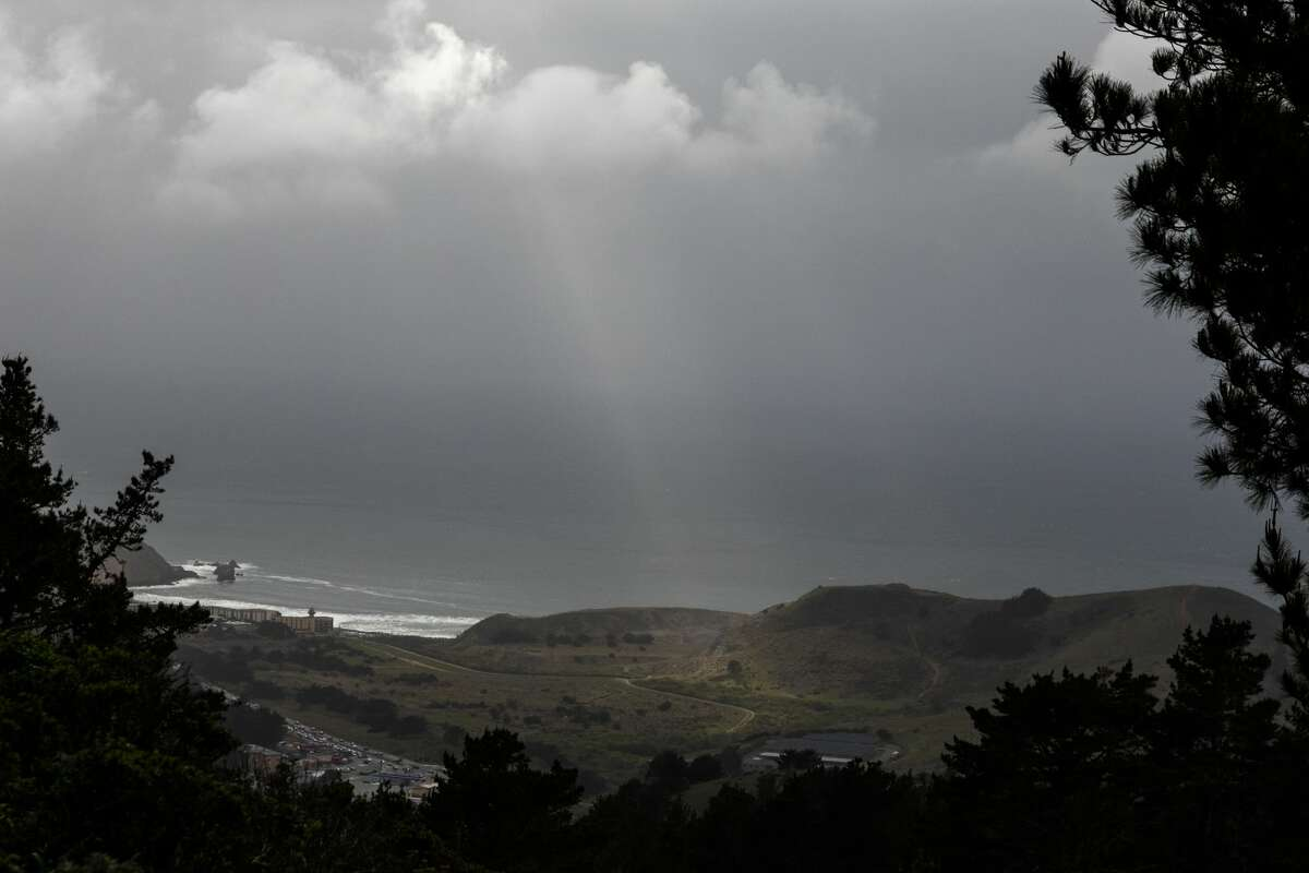 A beam of sunlight splits the clouds on the climb down. The Sweeney Ridge hike includes some steep climbs and remarkable views on the way to the San Francisco Bay Discovery Site. The site is where the Portola expedition discovered San Francisco Bay.