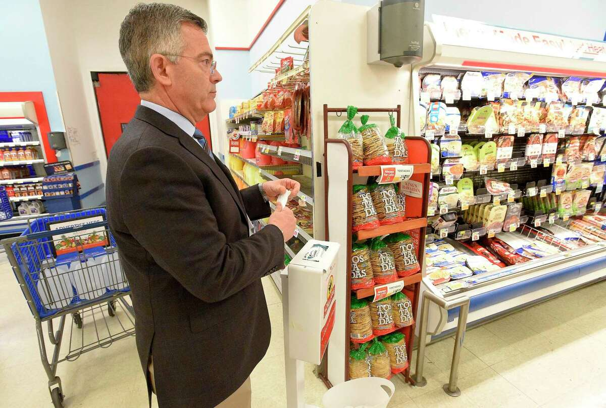 Tom Cingari, President and Owner of several Shop Rite Food Markets in Stamford and Norwalk, uses a sanitizer wipe to clean his hands as he walks his Stamford, Connecticut store on March 14, 2020. With the outbreak of the COVID-19 Coronavirus, Cingari and his staff have taken a pro-active approach, setting up hand sanitizing stations through out the store for customers to use. Providing protecting gloves for use by staff as well as customers. Cleaning