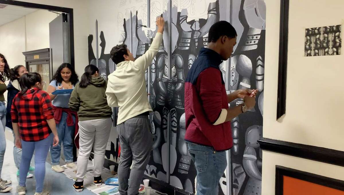 Members of the National Art Honors Society work on a mural at Stamford High School that was started in 2015 by a student.