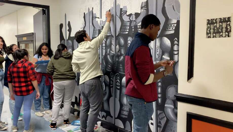 Members of the National Art Honors Society work on a mural at Stamford High School that was started in 2015 by a student. Photo: Sarah Wargo / Contributed Photo / Stamford Advocate contributed