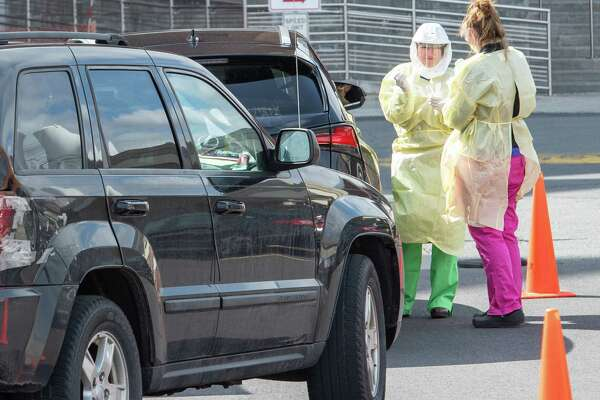 Technicians at the Albany Medical Center Hospital in Albany NY at the site set up to test people for COVID-19, also known as the coronavirus, on Saturday, March 14, 2020 (Jim Franco/Special to the Times Union.)