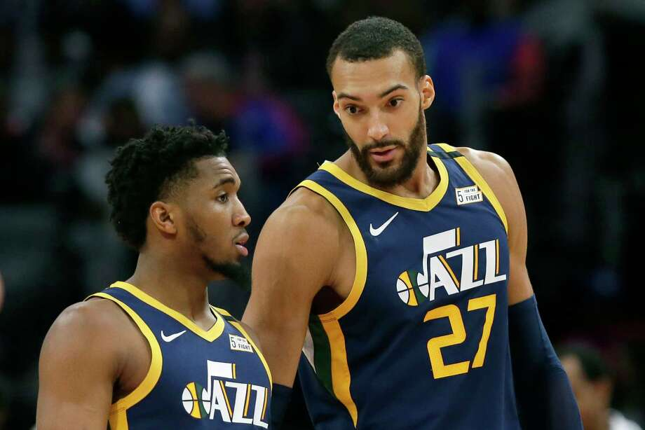 FILE - In this Saturday, March 7, 2020, file photo, Utah Jazz center Rudy Gobert (27) talks with guard Donovan Mitchell, left, during the second half of an NBA basketball game against the Detroit Pistons, in Detroit. Both players have tested positive for the coronavirus.  Gobert's test result forced the NBA to suspend the season. (AP Photo/Duane Burleson, File) Photo: Duane Burleson, Associated Press / Copyright 2020 The Associated Press. All rights reserved.