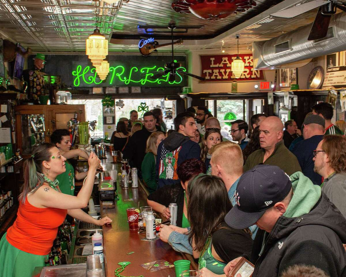 Revelers celebrate St. Patrick's Day at McGeary's Irish Pub in Albany on Saturday, March 14, 2020, despite the cancellation of the annual parade to help stop the spread of the coronavirus (Jim Franco/Special to the Times Union.)