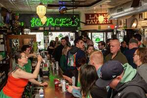 Revelers celebrate St. Patrick's Day at McGeary's Irish Pub in Albany, NY, on Saturday, March 14, 2020 despite the cancelation of the annual parade to help stop the spread of the coronavirus (Jim Franco/Special to the Times Union.)