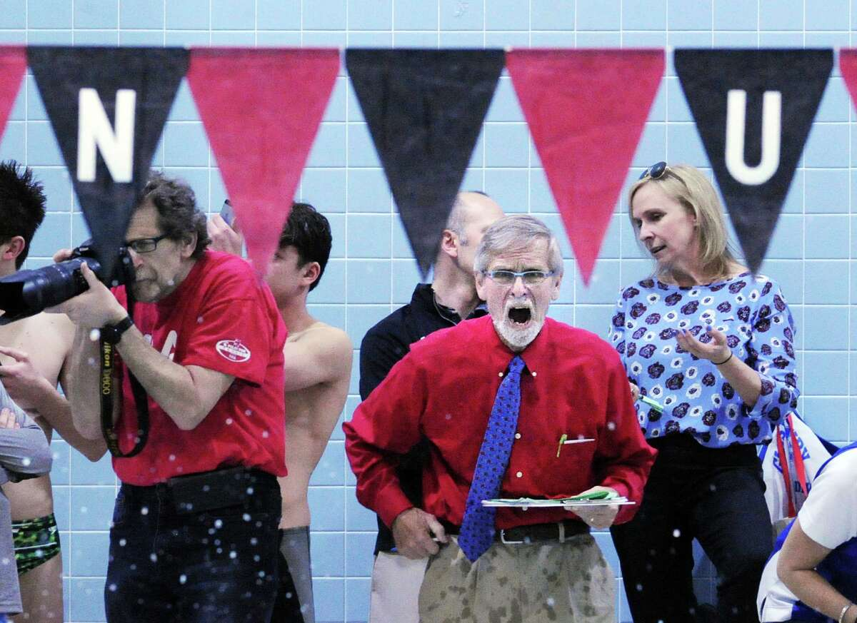 Greenwich swim coach Terry Lowe cheers for his swimmer Alex Jahan of Greenwich who was competing in the 200 IM event that he won during the CIAC boys class LL swimming championships at Wesleyan University, Middletown, Conn., Wednesday, March 16, 2016.