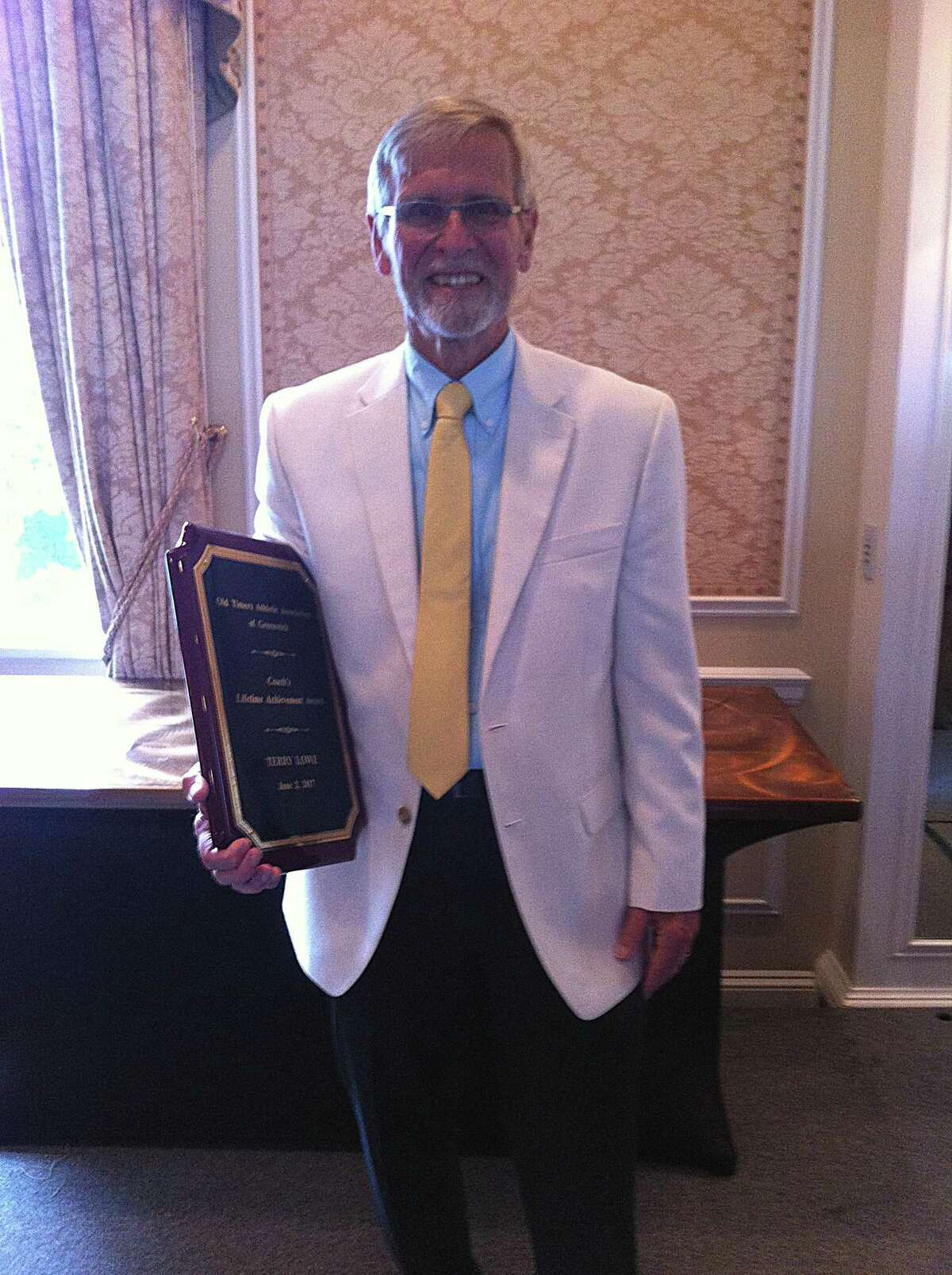 Terry Lowe received the Greenwich Old Timers Athletic Association 2017 Coach's Lifetime Achievement Award on Friday, June 2, 2017 at Greenwich Country Club.
