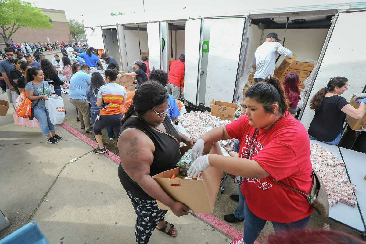 The Houston Independent School District along with the Houston Food Bank handed out food to hundreds of families in need Saturday, March 14, 2020, in Houston.