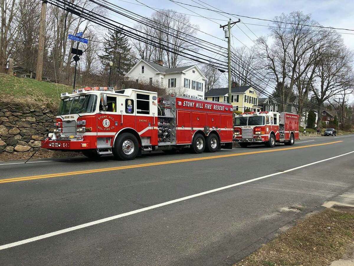 Firefighters on scene for a reported fire on Greenwood Avenue in Bethel, Conn., on Saturday, March 14, 2020.