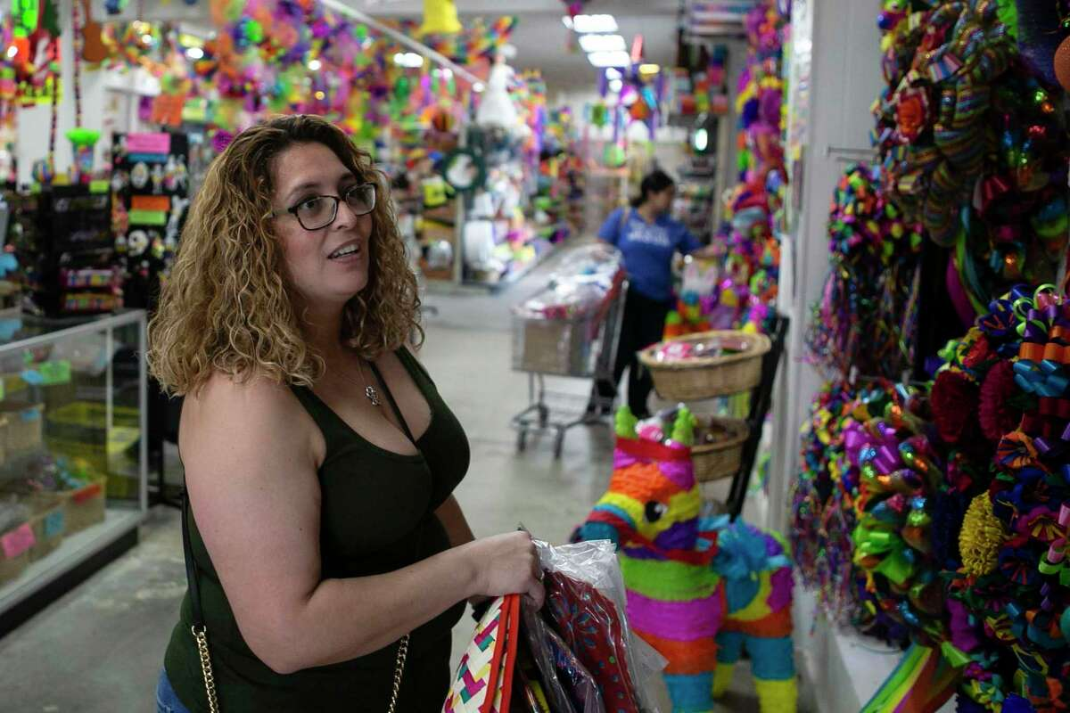 Susan Sepulveda shops for decorations for her daughter's graduation party at Amol's Party Supply. The shop usually sells a lot of Fiesta-related items this time of year.