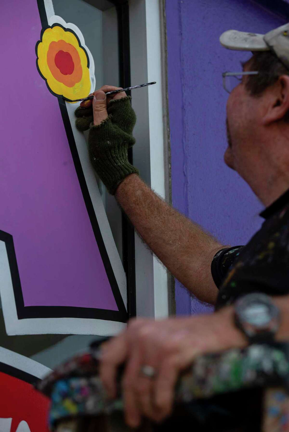 Robert Fassell paints an advertisement for Fiesta on the window of Amol's Party Supply in San Antonio, Texas, on March 13, 2020. Earlier on Friday, it was announced that the annual Fiesta celebrations in San Antonio, normally held in April, will be postponed until November this year due to concerns of coronavirus.