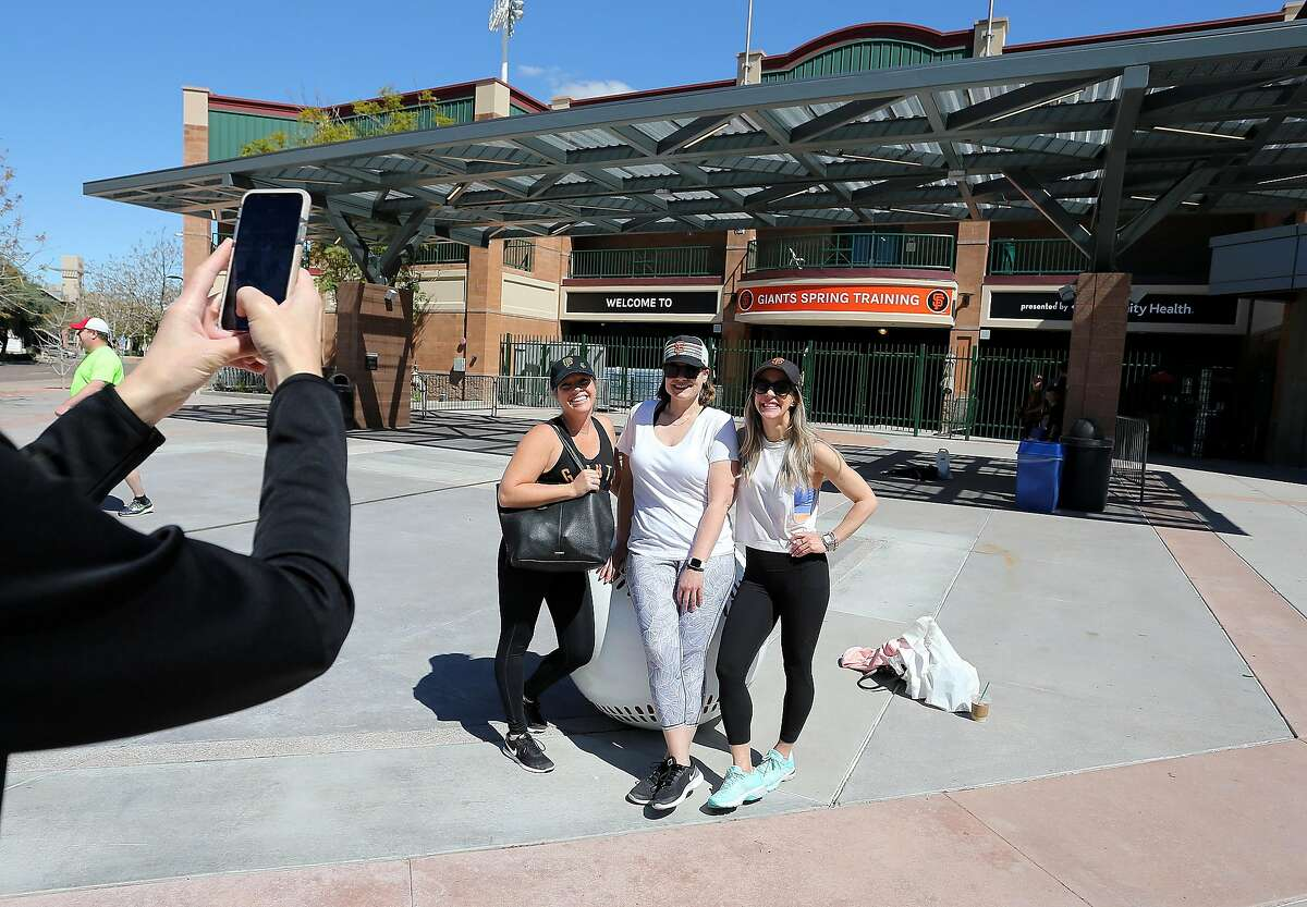 Making the best of their situation, San Francisco's Caitlyn Schalih, Julie Koppel and Nina Manke poses after making it to Scottsdale Stadium home of their San Francisco Giants Saturday, March 14, 2020, in Scottsdale, Arizona.