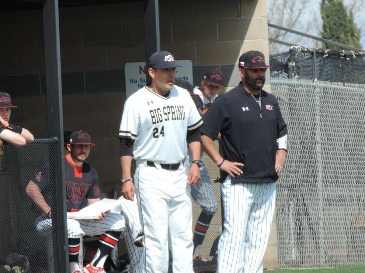 Big Spring head coach Daniel Carrillo, left, and Levelland head coach Brent Paris chat in-between innings during Saturday's baseball tripleheader at Steer Park. Photo by Christopher Hadorn/Reporter-Telegram