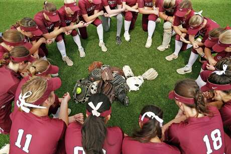 Trinity player gather for prayer with all their gloves placed in the middle. Texas Lutheran Lutheran defeated Trinity 5-3 in the first game of a double header on Saturday, March 14, 2020 at Texas Lutheran.