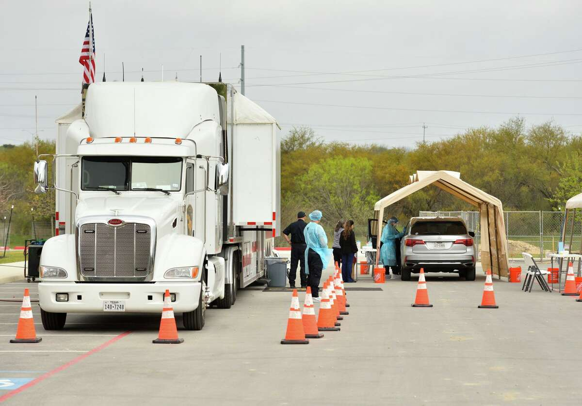 A driver pulls into a drive-through coronavirus testing site at the Texas Medical Center on Saturday, March 14, 2020. The first of its kind to open in Texas, it is designed to make testing more readily available.