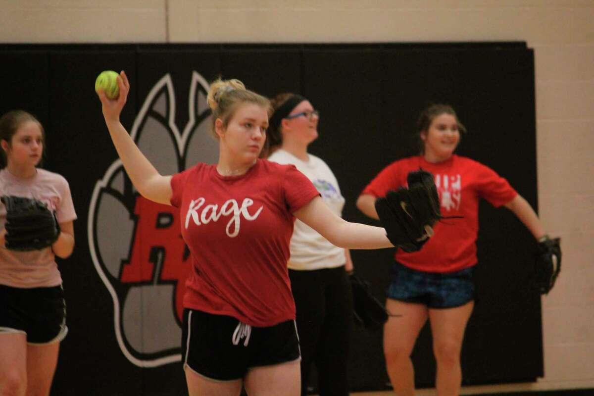 Reed City senior Cassie Enos warms up her arm during softball practice last week. (Pioneer photo/John Raffel