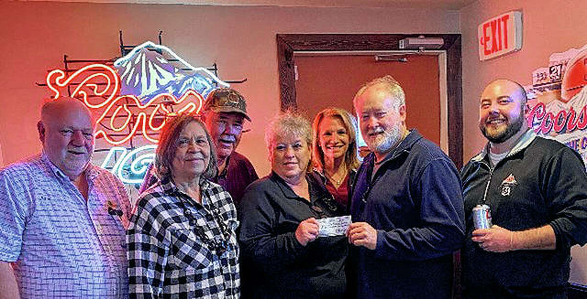 """Jacksonville Speedway held its 32nd annual Chili Cook-Off on Feb. 16, raising more than $7,000 to benefit the Jacksonville Dream Center Foundation. Deb Cason (center) of Barney's and Jacksonville Speedway presents Steve Cantrell of Jacksonville Dream Center (second from right) with a check representing proceeds from the cook-off. Others on hand for the presentation were Danny Kindred (from left) of Don's Place; Marilyn Sorrill of Jacksonville Dream Center; and Mike Sullivan, Mary Walker and Cody Lawson, all of Robert """"Chick"""" Fritz Distributing. The Speedway will have its annual Spring Wing Ding on April 18."""