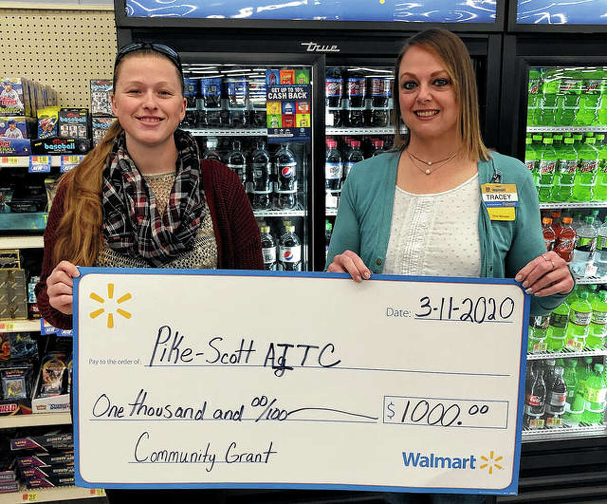Two Rivers Farm Bureau Foundation has received a $1,000 Community Grant from Walmart in Pittsfield to benefit the Pike-Scott Agriculture in the Classroom program. Agriculture Literacy coordinator Rachel Poor (left) accepted from Pittsfield Walmart manager Tracey Synder a check representing the grant.