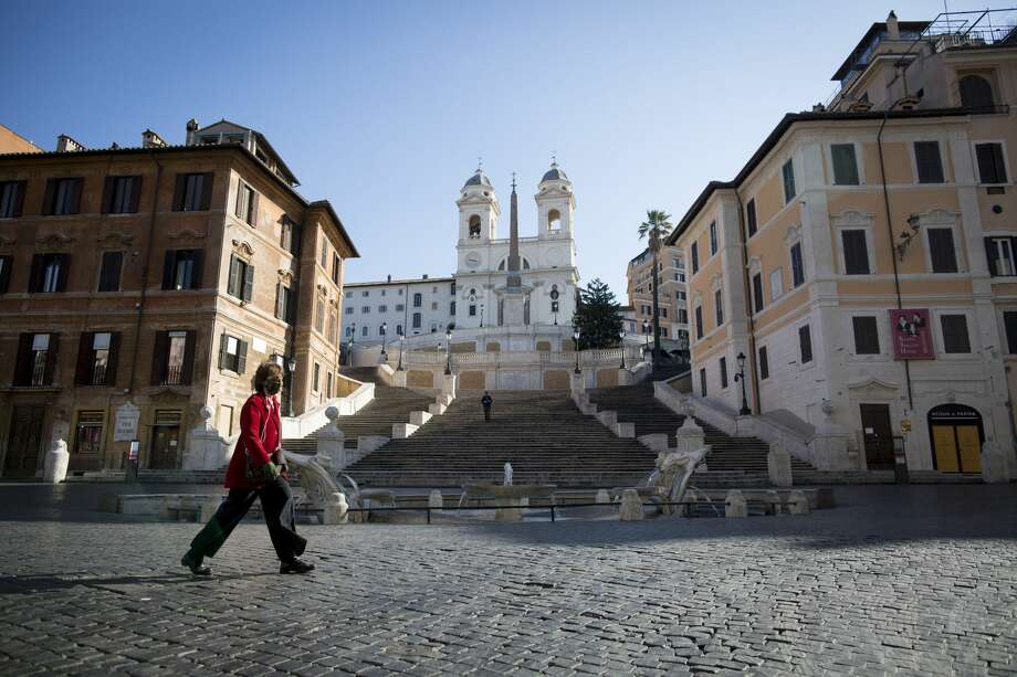 Coronavirus: Empty streets, attractions, stadiums around the world A woman walks in almost empty Piazza di Spagna as Italian government continues restrictive movement measures to combat the coronavirus outbreak in Rome, on March 15, 2020. Italy imposed the closure of all stores except for pharmacies and food shops in a desperate bid to control the deadly COVID-19 coronavirus. Photo: NurPhoto/NurPhoto Via Getty Images